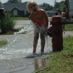 Rachel in water, kids playing