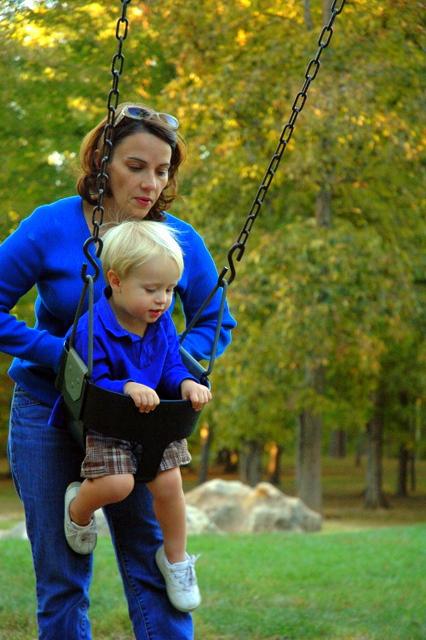 boy in swing, fall, park, leaves